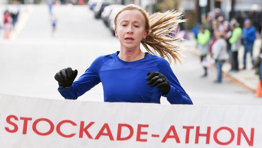 Cara Sherman crosses the finish line as the women's winner Sunday
