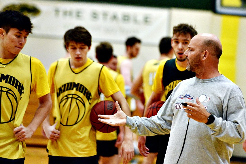 Joe Burke, right, is shown with his Skidmore team at last Friday's practice.