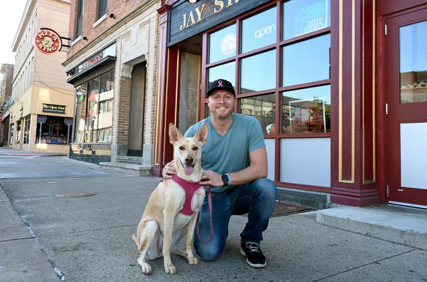 """Mitch Ramsey, owner of the Jay St. Pub, is pictured with dog """"Nala."""""""