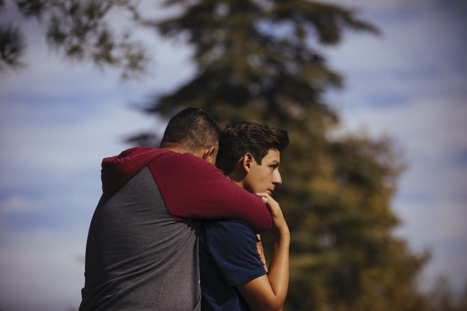 Students are reunited with their parents after a shooting at Saugus High School in Santa Clarita, Calif., Nov. 14, 2019.