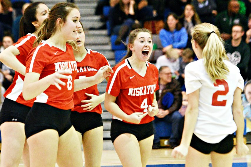 Niskayuna girls' volleyball celebrates its Section II Class AA Championship win last Saturday.