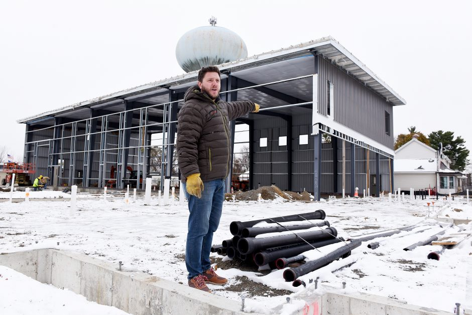 Common Roots co-owner Christian Weber shows off their brewery under construction in South Glens Falls.