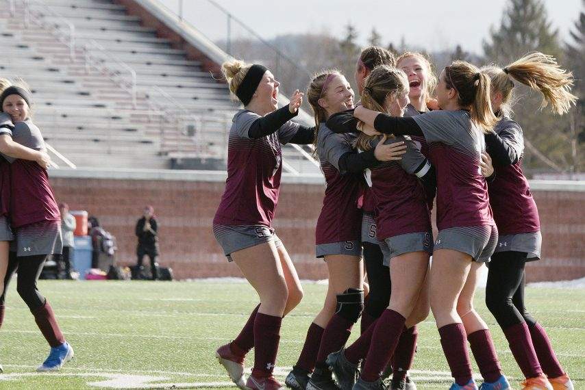The Stillwater soccer team celebrates after Paige Brinsko's goal in the state Class C title game.