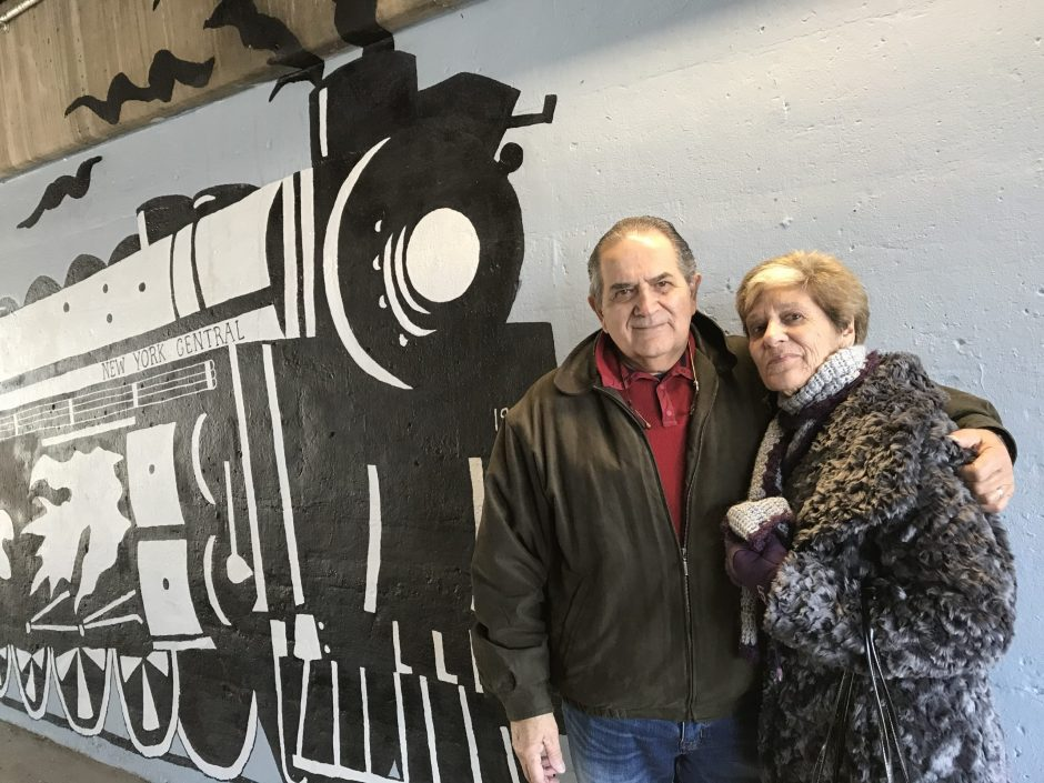 Paul Casillo and Marilyn Cardinal pose in front of a mural on East Front Street.