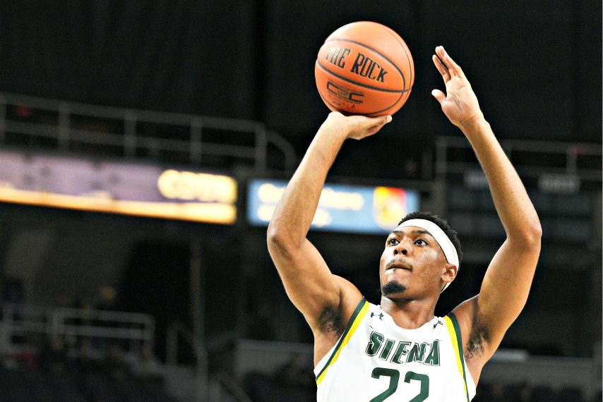Jalen Pickett takes a shot during a game earlier this season.