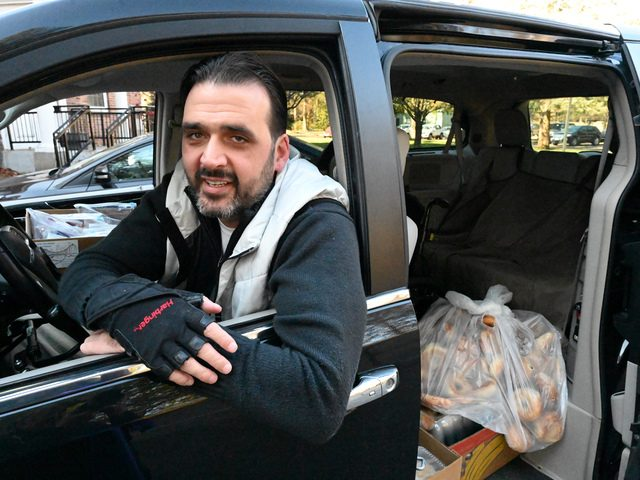 """Doug Bartling of """"Over the Bridge Outreach"""" gets ready to leave the First Reformed Church of Scotia with food and goods."""