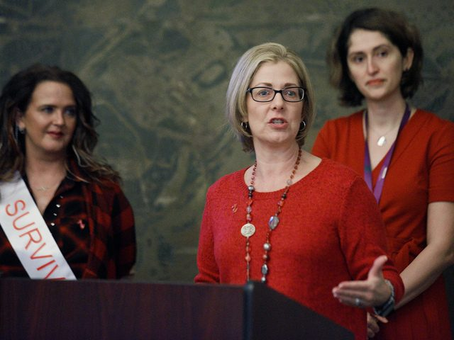 City of Saratoga Springs Commissioner of Finance Michele Madigan, center, speaks at a Go Red For Women Luncheon on Jan. 31.