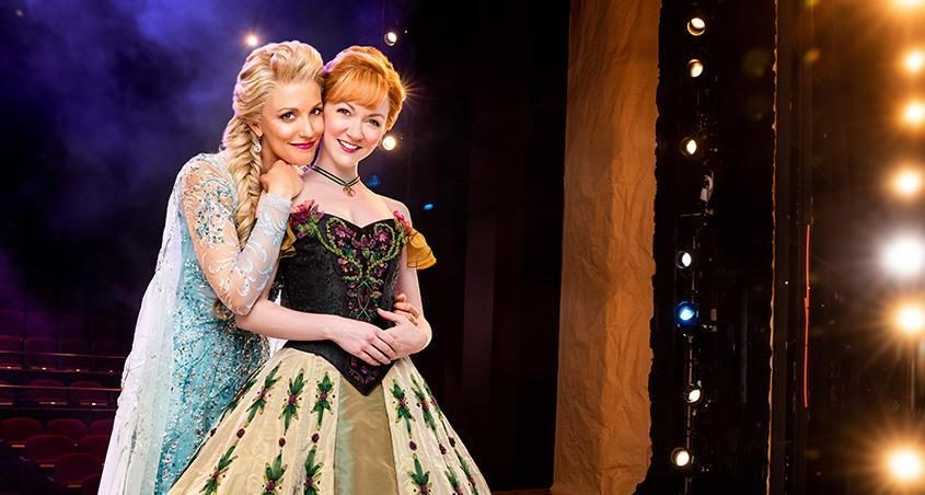 """Caroline Bowman, left, as Elsa and Caroline Innerbichler as Anna in the touring production of Disney's """"Frozen."""""""