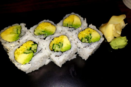 Avocado, mango and cucumber sushi was served with two sauces.