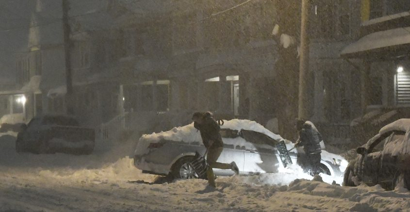 Motorists attempt to dig their vehicles out of the snow on Eastern Avenue in Schenectady Sunday