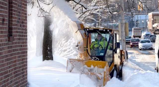 Clearing snow on Broadway in Schenectady Tuesday