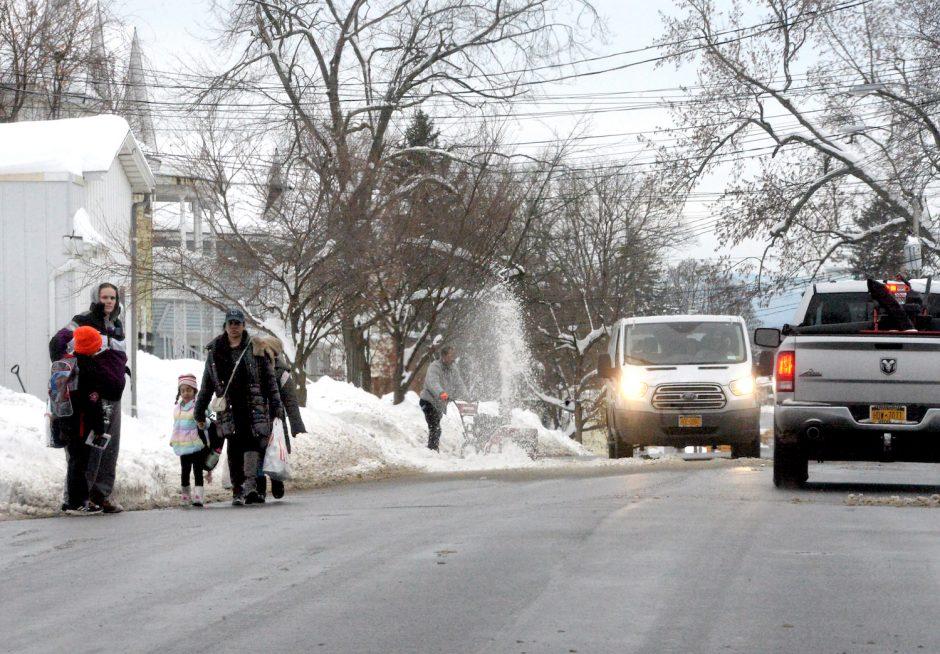 Families walking in road near Van Corlear Elementary on Guilderland Ave. after school on Wednesday.