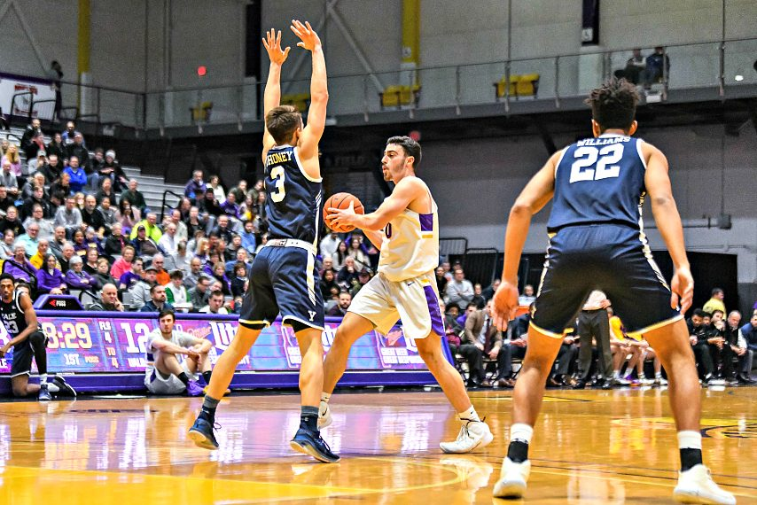 Yale freshman August Mahoney, left, defends UAlbany's Antonio Rizzuto during Wednesday's game.