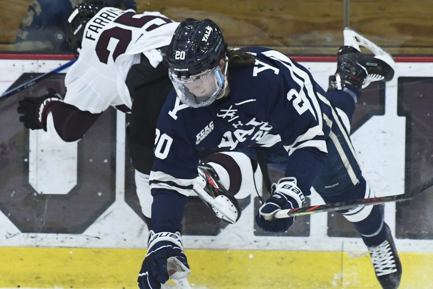 Union's Owen Farris (25) collides with Yale's Curtis Hall at Messa Rink on Saturday.
