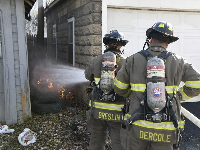 Schenectady firefighters Courtney Breslin and Lt. TJ Dercole extinguish a small debris fire in Center Alley in November.