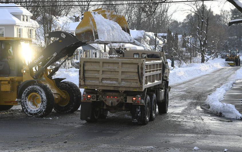 A Schenectady front end loader dumps snow into the back of a truck at Eastern Parkway and DeCamp Avenue on Wednesday.