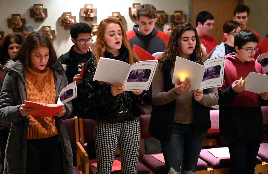 The Amsterdam High School choir sings during St. Mary's Healthcare Auxiliary's annual tree lighting Monday, December 9, 2019.