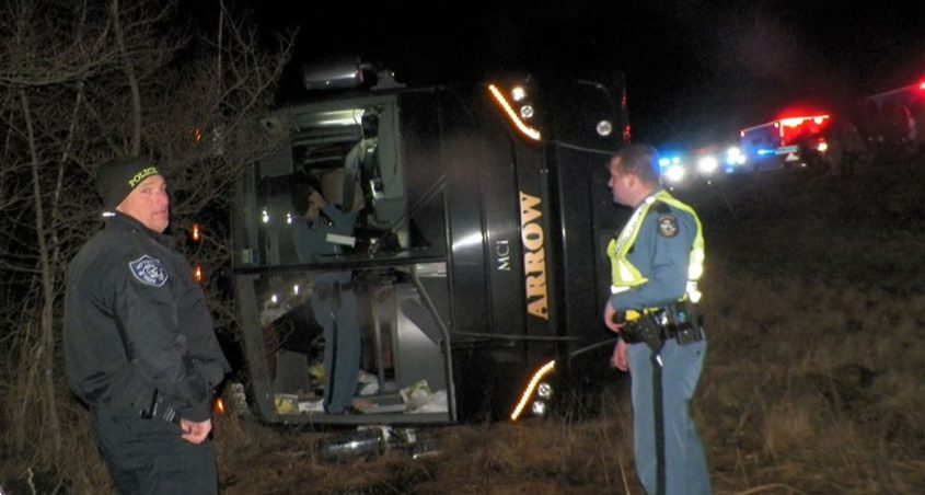 Maine State Police at the overturned bus