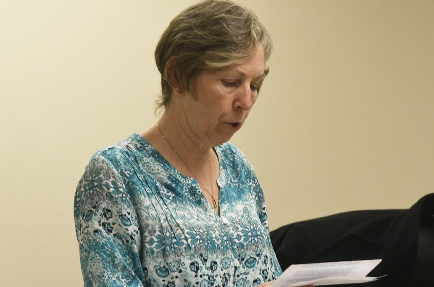 Root Town Clerk Sherrie Eriksen reads a brief statement during a Town Board meeting on April 10.