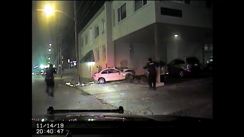 Deputies approach the crashed car Nov. 14 in this dash cam video still