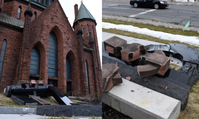The toppled sign at St. John the Evangelist Sunday morning