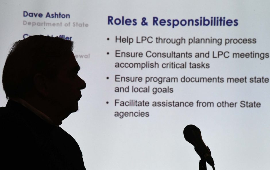 Schenectady Mayor Gary McCarthy is silhouetted against a PowerPoint presentation Tuesday evening at SUNY Schenectady.