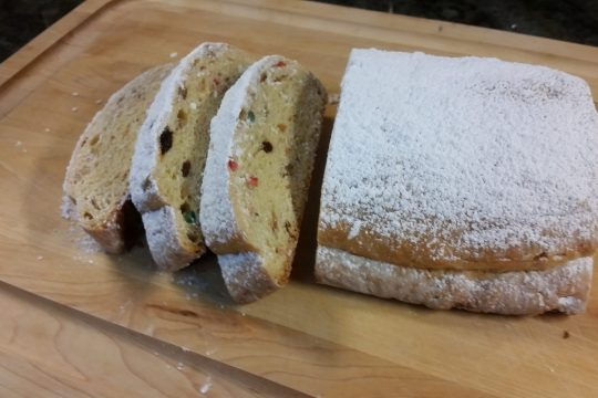 Sliced Christmas stollen, ready to serve.