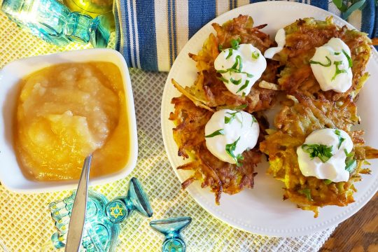 Latkes — served with sour cream or applesauce — along with brisket, top, remain Hanukkah favorites.