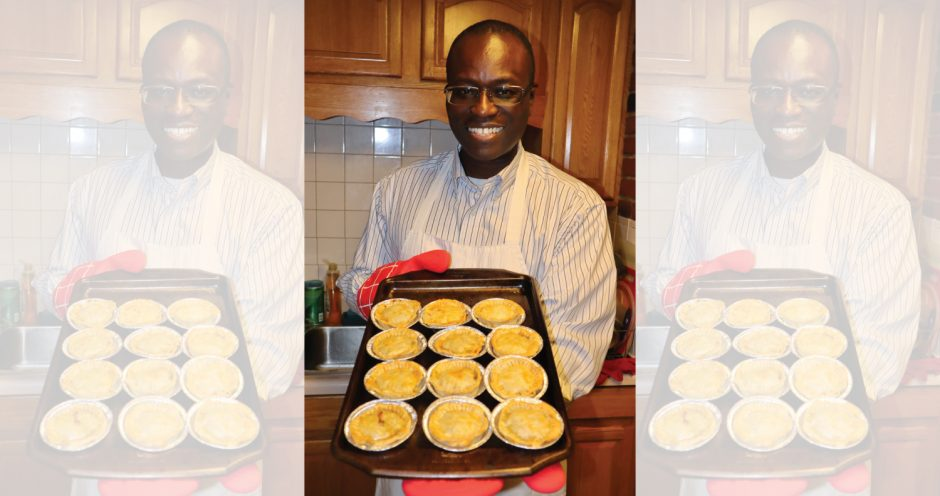 Philip Fields, who was born in Guyana, shows off beef patties.