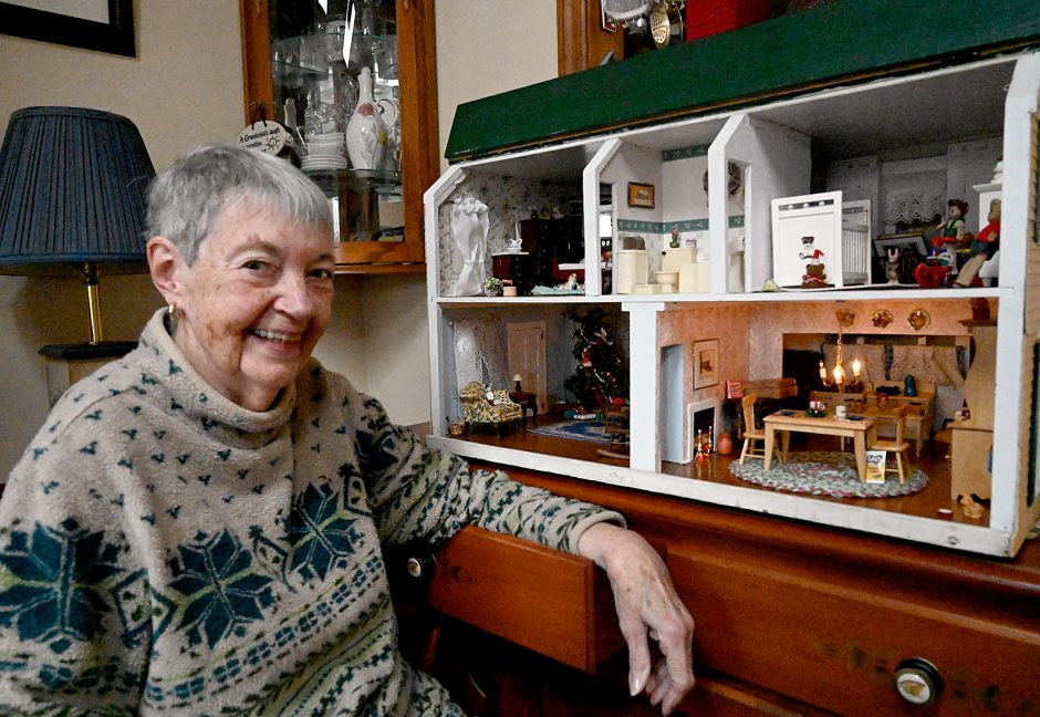 Rotterdam resident Nancy Bedard shows off the dollhouse she received as a Christmas gift in 1944.