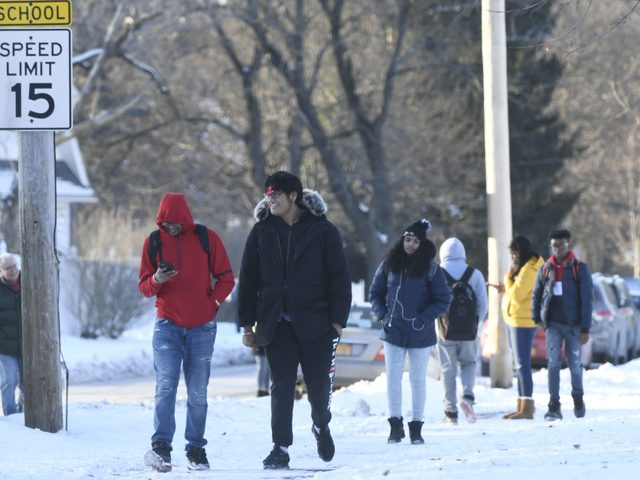 Schenectady High School students walk towards their homes after being dismissed for the holiday break on Friday.
