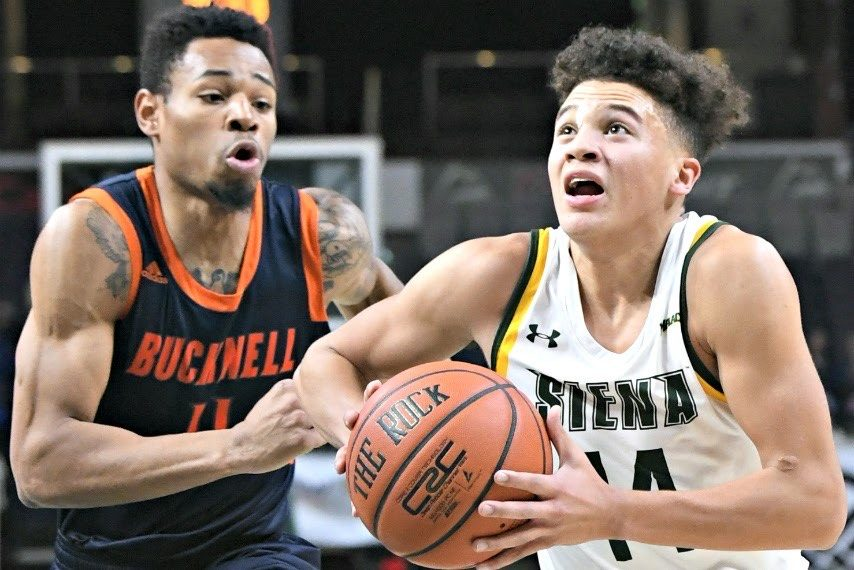 Siena's Jordan King drives against Bucknell Saturday night at the Times Union Center.