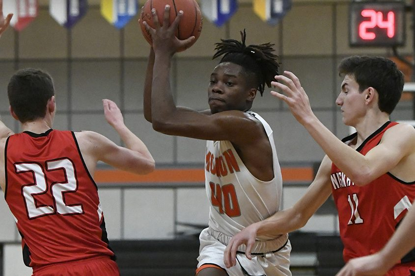 Mohonasen's Shawn Gillisslee drives to the basket between Niskayuna's Owen Evans and Ethan St. Lucia.