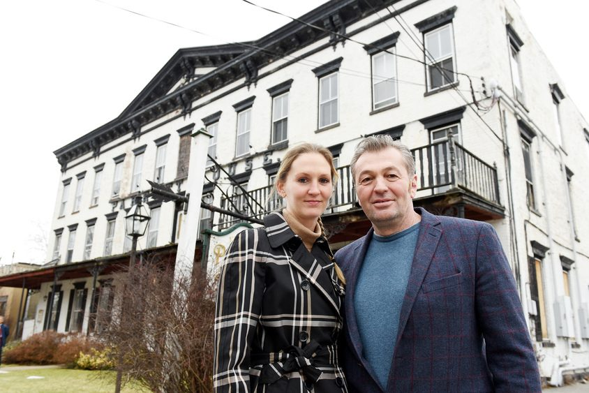 The new owners of the Parrott House on Main Street, Alex von Zehle and Nick Ahmetaj, stand in front of the building Friday.