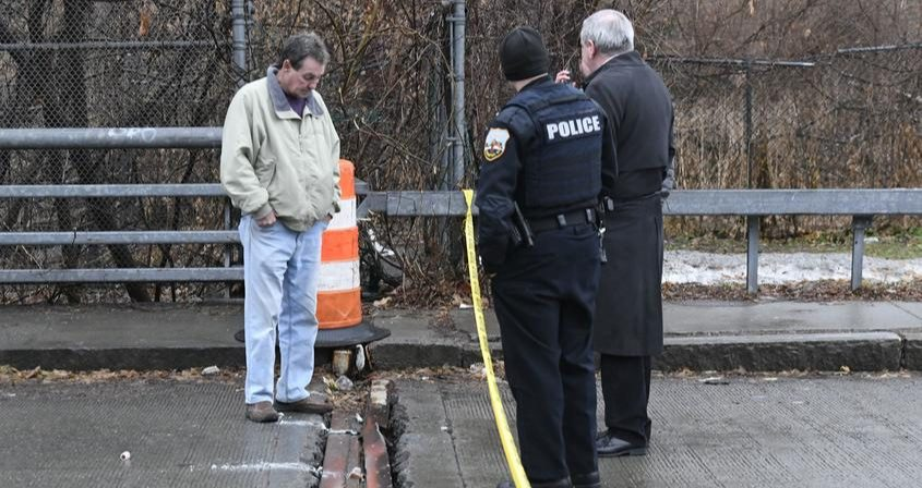 Schenectady officials inspect the Cotton Hollow Factory Bridge after it was closed on Saturday.