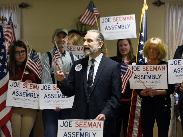 Activist Joe Seeman announces his run to represent the state's 112th Assembly District on Monday.