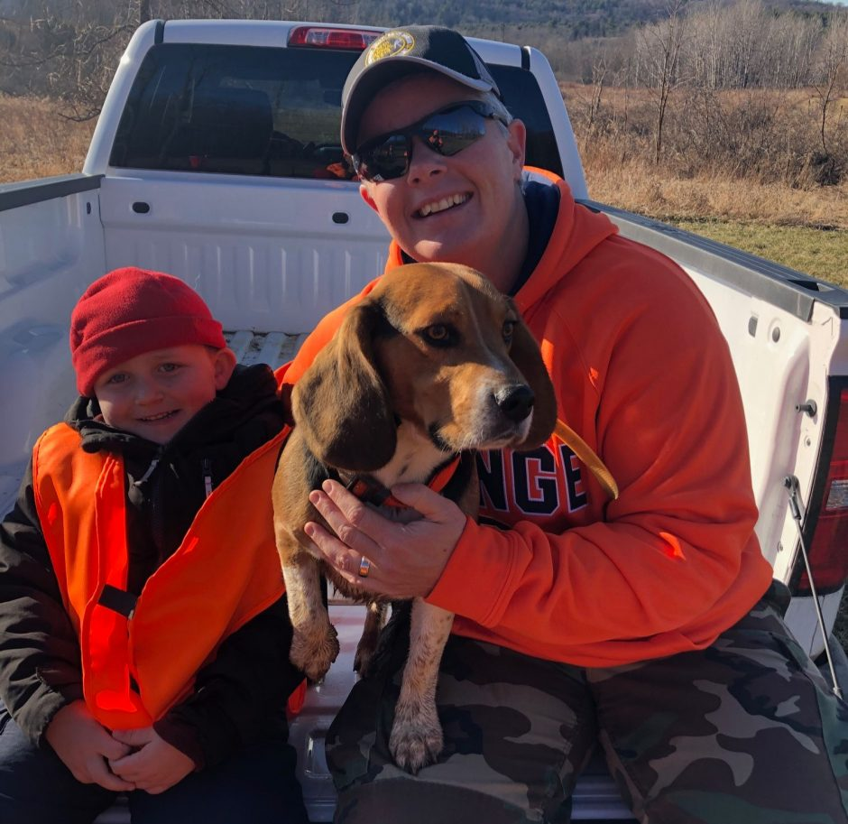 Micki Guy with her 5-year-old son Tristan and their beagle trooper.