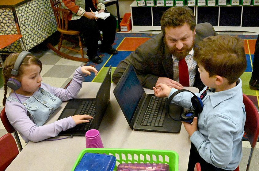 Paul Pecorale, vice president of NYSUT, talks to first-graders in Rachel Schulde's first-grade class at Bradt School.