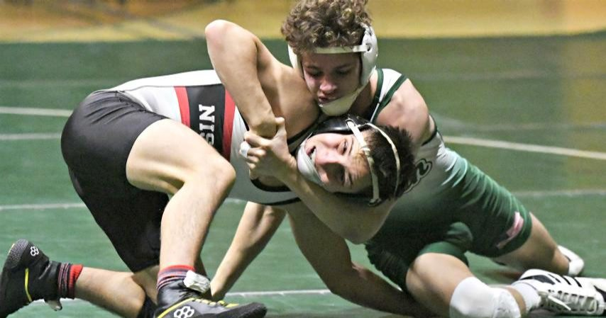 Niskayuna's Jack Schiavo, left, grapples with Shenendehowa's Joey Scheeren.