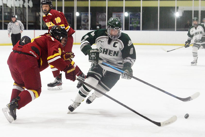 Shenendehowa's Tyler Sullivan skates with the puck against Ithaca's Dennis Kang on Saturday.
