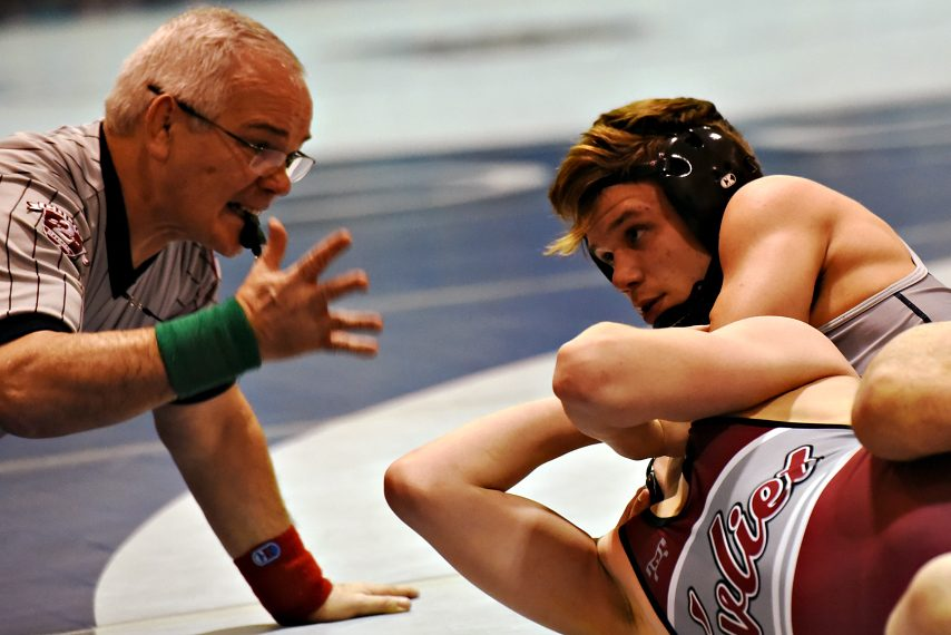 Cobleskill'S Greg Hotaling looks up at referee Todd Cary with Watervliet's Tyler Senecal in his clutches Tuesday night.