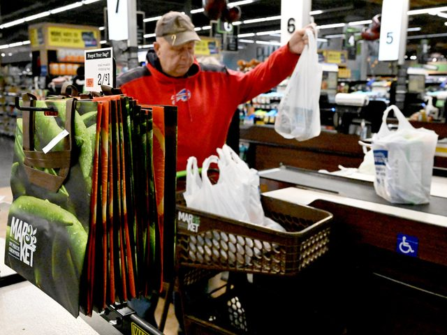 Frank Stekeur of Scotia prepares to place a single-use plastic bag filled with grocery items in his cart.