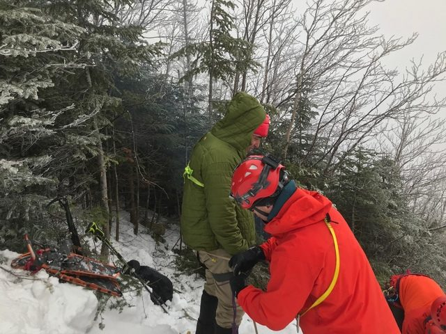 New York State forest rangers assist an injured hiker down Macomb Slide in the Dix Wilderness earlier this month.