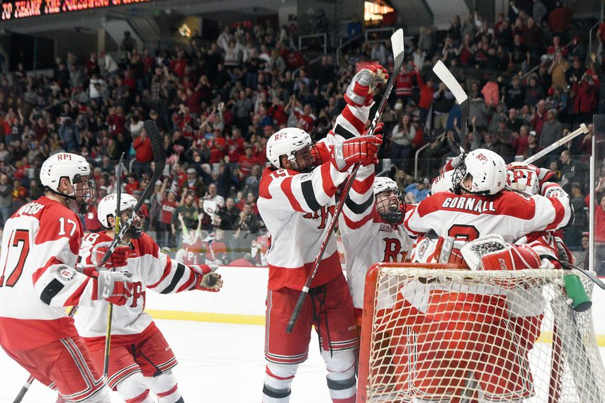 The RPI Engineers mob goalie Owen Savory after beating Union in a shootout to claim the Mayor's Cup.