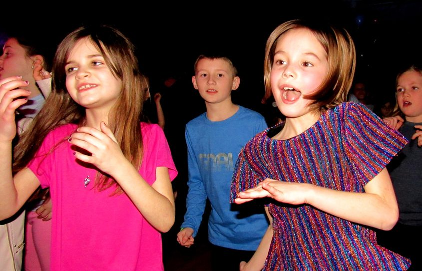 """Fourth-graders Keira Vadney, left, and Lily Ramos groove during """"Boogie Night"""" at Hillside Elementary School."""