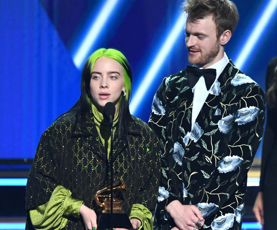 "Billie Eilish, left, and Finneas O'Connell accept the song of the year award for ""Bad Guy."""