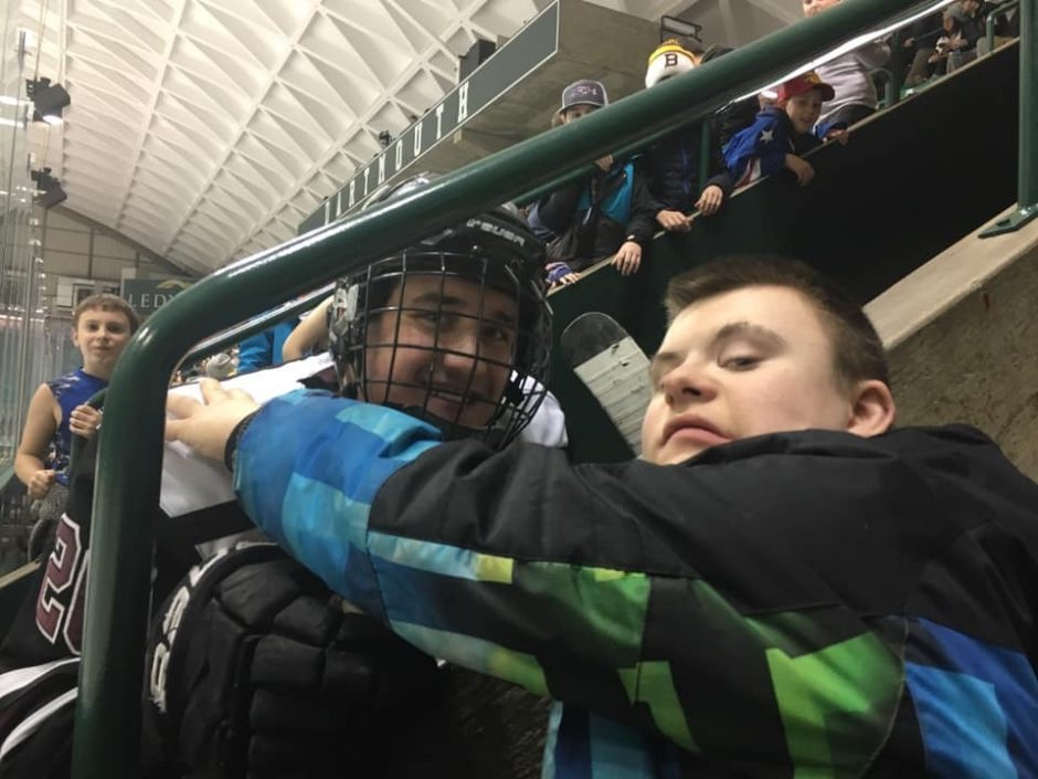 Dutchmen forward Josh Kosack is pictured with fan Patrick Toner at Dartmouth.
