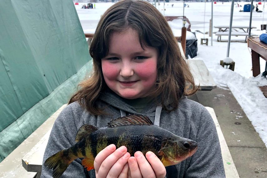 10-year-old Amber Ryther, of Lake George, with her perch.