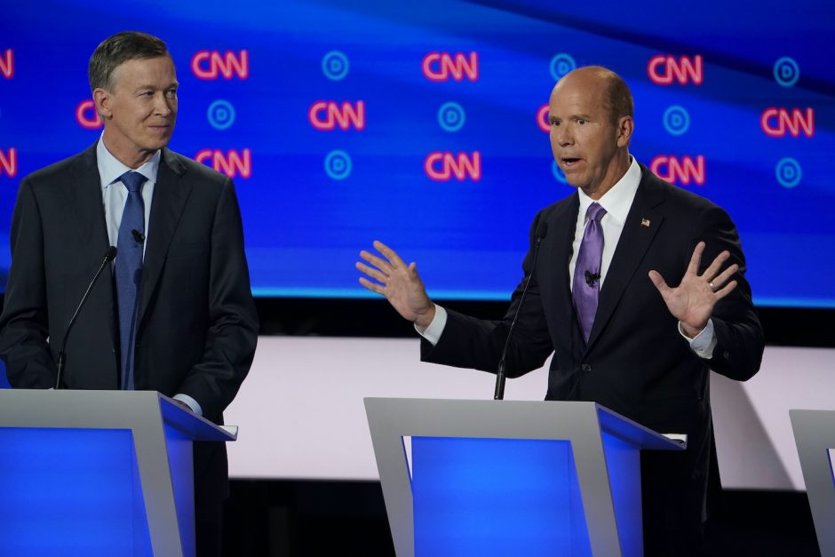 Former Rep. John Delaney of Maryland, right, during the first night of Democratic presidential debates, in Detroit, July 2019.