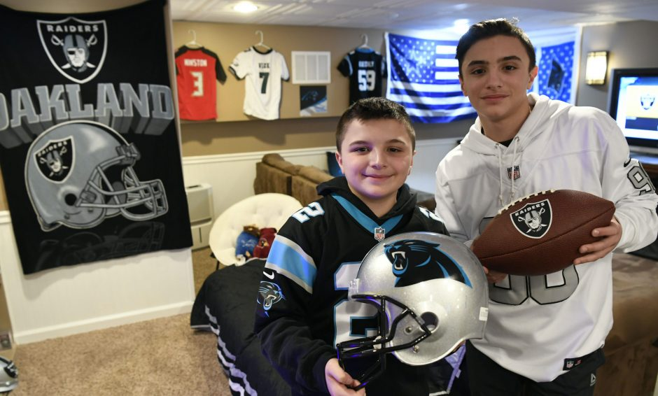 Lucas Giardono, 11, and his brother Nick Giardono, 14, in their self-designed NFL Man Cave.